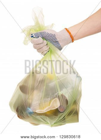 Package with household waste in woman hand isolated on white background.