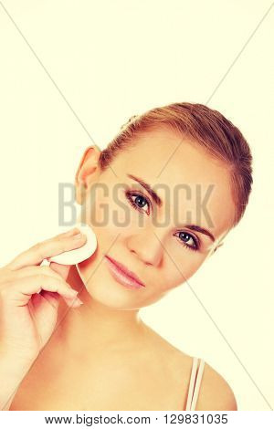 Beautiful woman using cotton pad