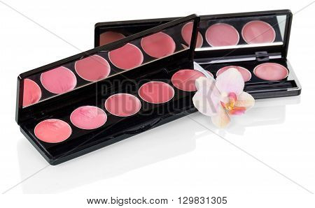 Palette gloss for lips and orchid flower isolated on white background.