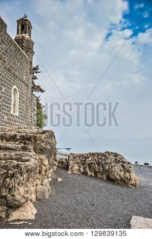 The Church of the Primacy - Tabgha on the Sea Gennesaret. Sea of Galilee in Israel. Jesus then fed with bread and fish hungry people