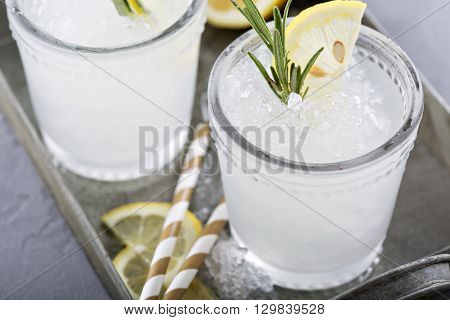 Lemon rosemary cocktail  in glasses on a tray