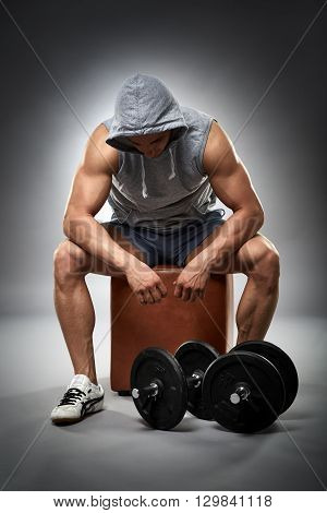 Exhausted Bodybuilder With Dumbbells