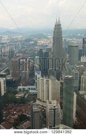 KUALA LUMPUR MALAYSIA - MAY 10 2016 : Kuala Lumpur skyline with the Petronas Towers and other skyscrapers. Aerial view from the Menara Kuala Lumpur Tower.
