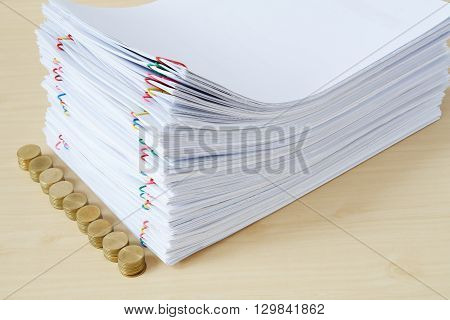 Pile Of Overload Paper With Pile Of Gold Coins