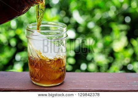 Iced coffee in mason jars outdoors on the front porch