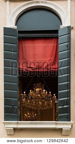 Brilliant Chandelier Inside Room And Red Curtain