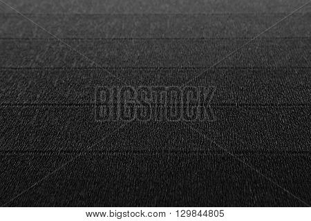 Abstract textured minimalist dark background with horizontal lines. The texture.