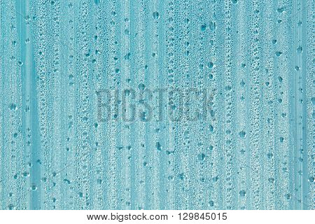 Water drops on the background. Condensate. Mint color background. Water drops background.