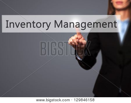 Inventory Management - Businesswoman Hand Pressing Button On Touch Screen Interface.