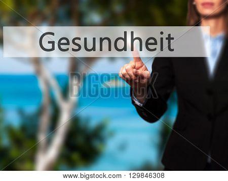 Gesundheit (health In German) - Businesswoman Hand Pressing Button On Touch Screen Interface.
