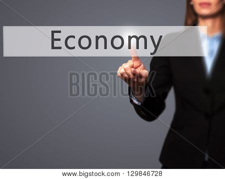 Economy - Businesswoman Hand Pressing Button On Touch Screen Interface.