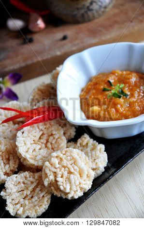 Above of Thai food rice cracker dish with spicy dip sauce