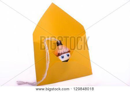little Ukrainian hut maket placed on an envelope
