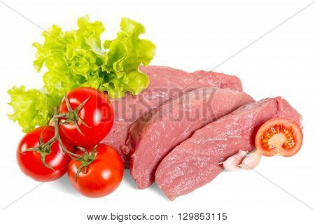 Chunks of fresh beef, lettuce and tomatoes isolated on white background.