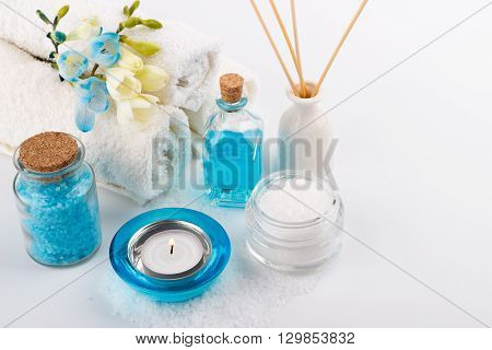 Spa setting aromatherapy and health care items on white