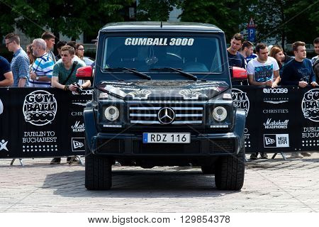 Bucharest, Romania, May 7, 2016: Super cars of the exclusive Gumboil 3000 parked in front of the Romanian Parliament. Gumball is an international celebrity rally which takes place on public roads.