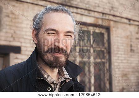 Portrait Of Young Bearded Urbanite Asian Man