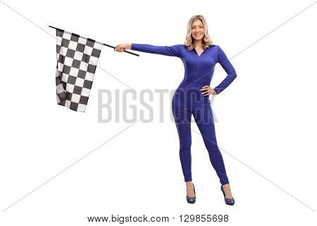 Attractive racing woman waving a race flag and looking at the camera isolate on white background