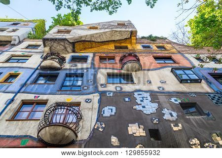 VIENNA AUSTRIA - 8TH MAY 2016: Low angle view of Hundertwasserhaus during the day in the summer.