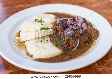 Typical serving of Beef Goulash and Bread Dumplings