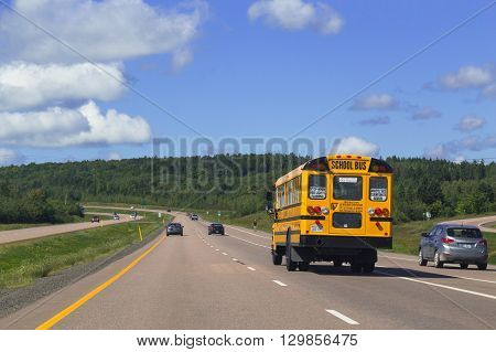 NOVA SCOTIA CANADA - 28TH AUGUST 2014: School Bus and rural roads in Nova Scotia Canada during the day.
