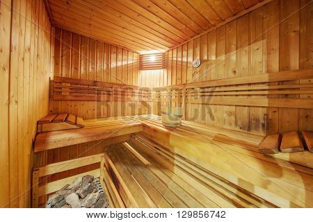 view of classic wooden sauna interior with light