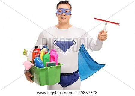 Young superhero holding a bunch of cleaning equipment isolated on white background