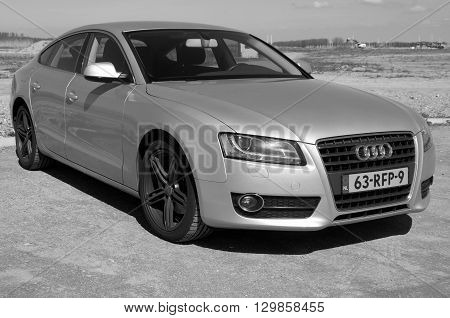 Almere, The Netherlands - May 1, 2016: Audi A5 parked on a public parking lot in the city of Almere.