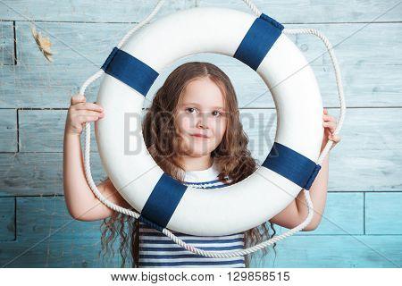 little girl looking through a lifebuoy closeup