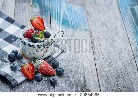 Fresh And Healthy Natural Yogurt With Berries On Wooden Table