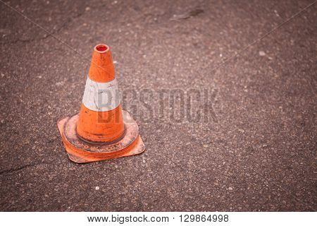 Color image of a traffic cone on tarmac.