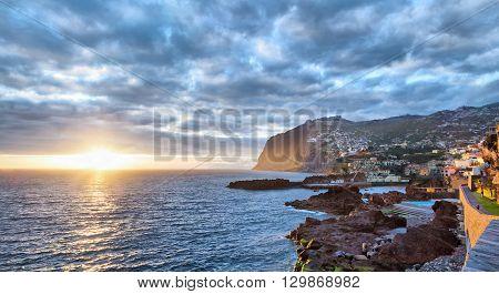 Sunset over Cabo Girao cliff viewed from Camara de Lobos Madeira Portugal