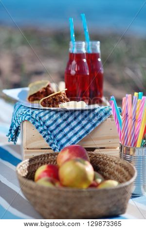 Fruits, snacks, and drinks during sea picnic