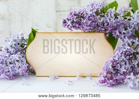 Wooden greeting card and wreath frame with lilac