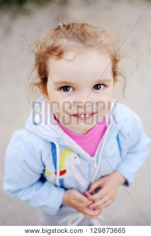 little girl with beautiful white teeth smiling at the camera.Children's kind eyes