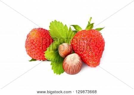 Strawberry with hazelnuts isolated on white background closeup.
