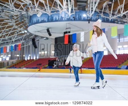 Smiling family at skating rink