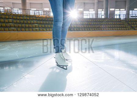 Female legs at skating rink