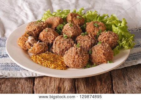 Tasty Meat Balls Bitterballen And Mustard Close Up On A Plate. Horizontal