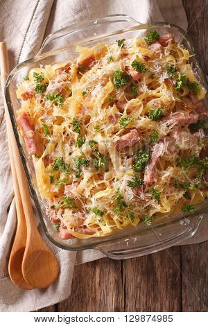 Casserole Noodles With Ham And Parmesan Close-up In A Baking Dish. Vertical Top View