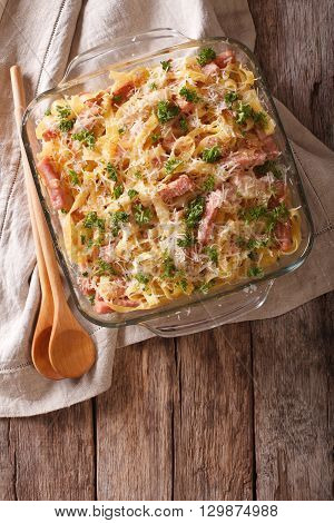 Noodles Baked With Ham And Cheese Close-up In A Baking Dish. Vertical Top View
