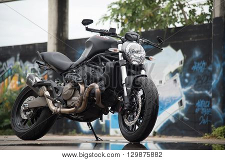 Prachuabkirikhan THAILAND - September 15 : Matte Black Ducati Monster 821 with beach and blue sea background on 2015 September 15
