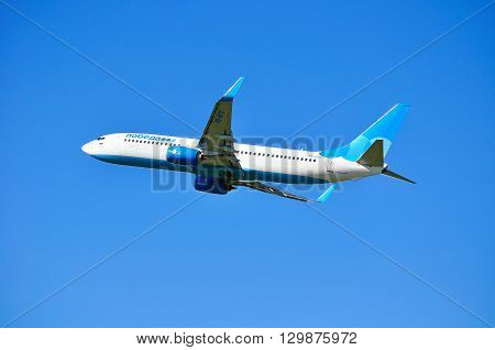 SAINT PETERSBURG RUSSIA - MAY 11 2016. Pobeda Airlines Boeing 737 Next Gen airplane -registration number VQ-BTC. Airplane is flying in the sky after departure from Pulkovo International airport
