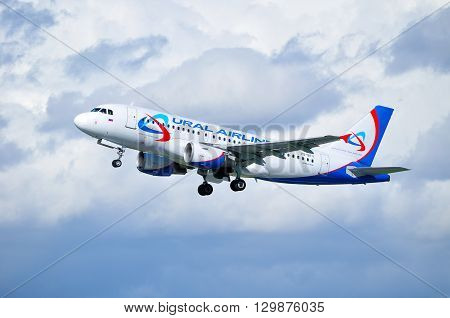 SAINT PETERSBURG RUSSIA - MAY 11 2016. Ural Airlines Airbus A319 aircraft -registration number VQ-BTY. Airplane is flying in the sky after departure from Pulkovo International airport