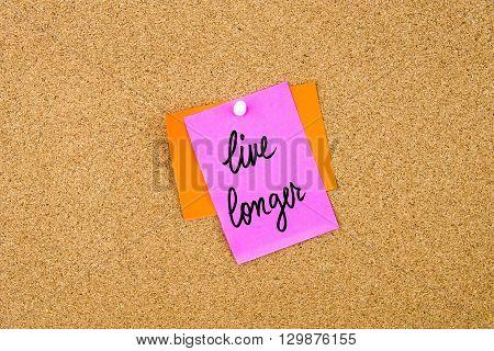 Live Longer Written On Paper Note