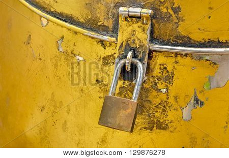Selective focus of old padlock with keyhole on steel casket