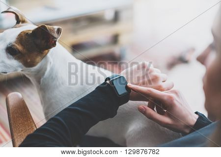 Photo Woman Working Modern loft, using generic design smart watch.Female Hands Touching screen smartwatch.Manager Work Process. Horizontal, Burred background. Film effects.