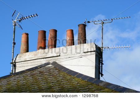 Old Brick Chimney Stack And Analogue Tv Aerials.