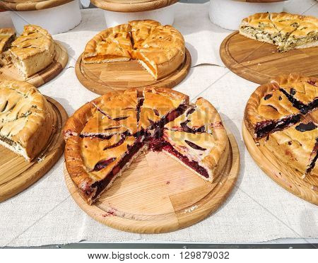 Pies with different fillings. Cut into pieces.