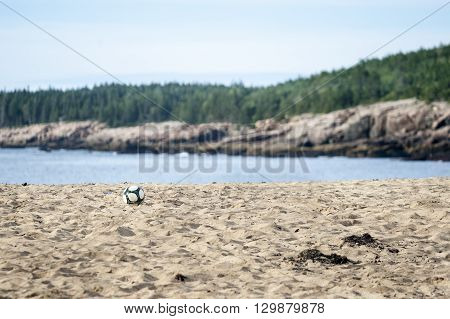 Soccer ball abandoned on beach in Acadia National Park